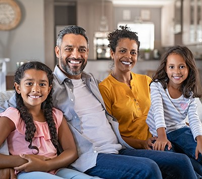 Happy multiethnic family sitting together